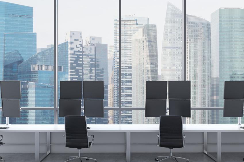 4 multiscreen trading workstations in a Singapore skyscraper