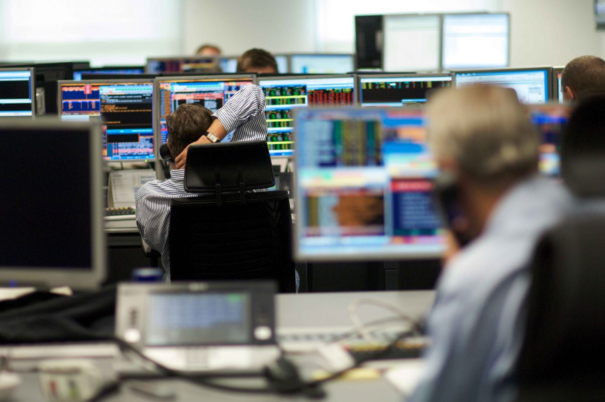 Capital Markets Traders on Phones at their Screens