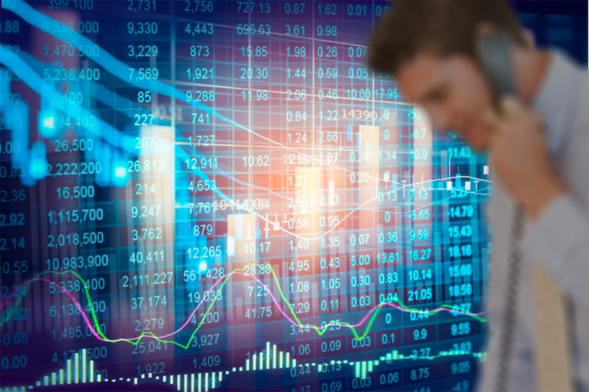 a voicetrader stands in front of trading data