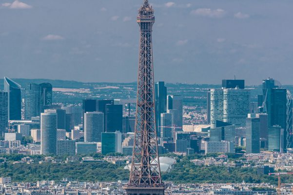 La Défense, Paris, viewed from MOnparnasse Tower with the Eiffel Tower in the foreground.
